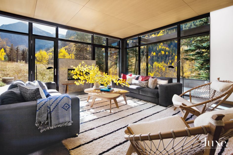 Modern Black Living Room with Floor-to-Ceiling Windows ...