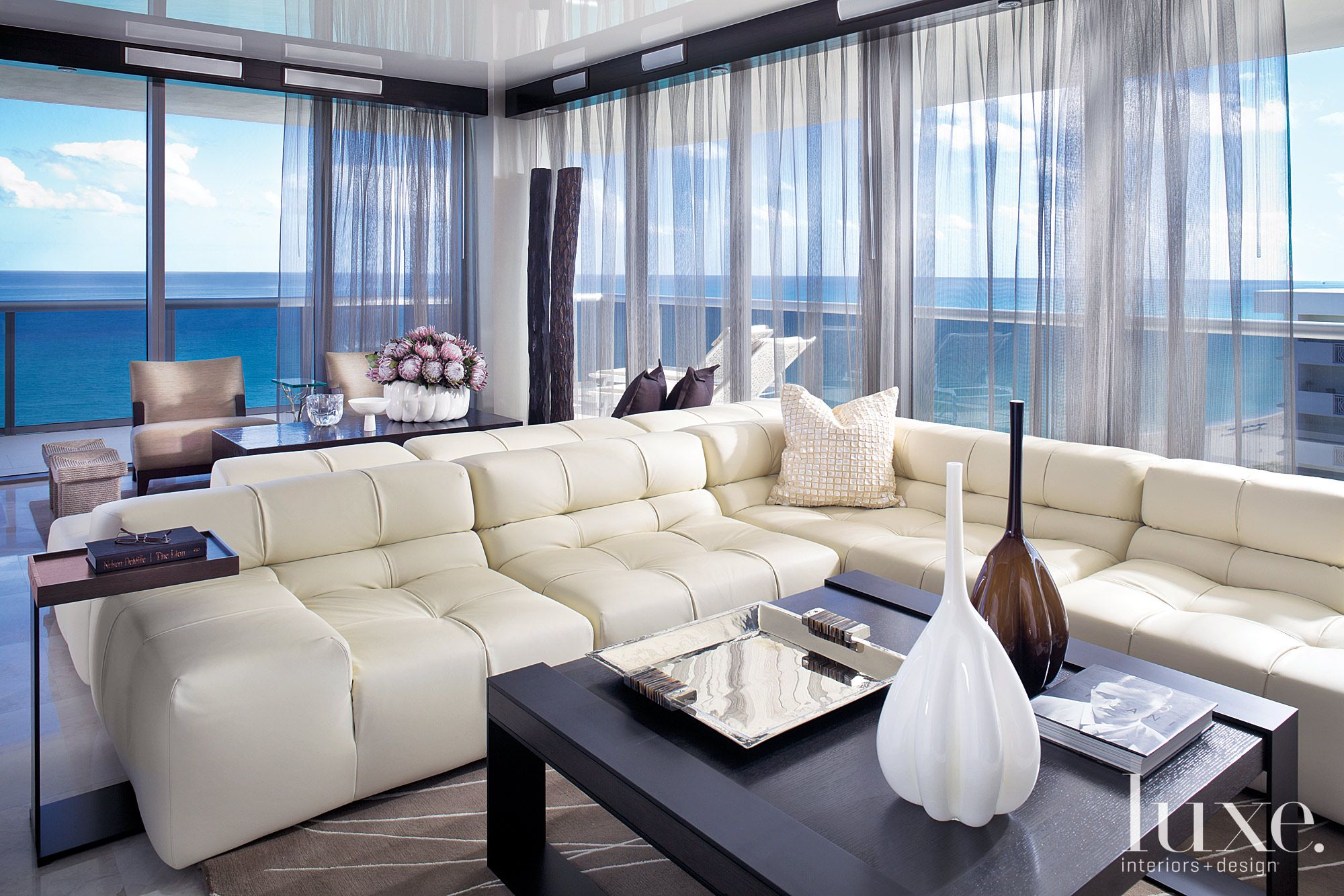 Contemporary Neutral Media Room with L-Shaped Sofas
