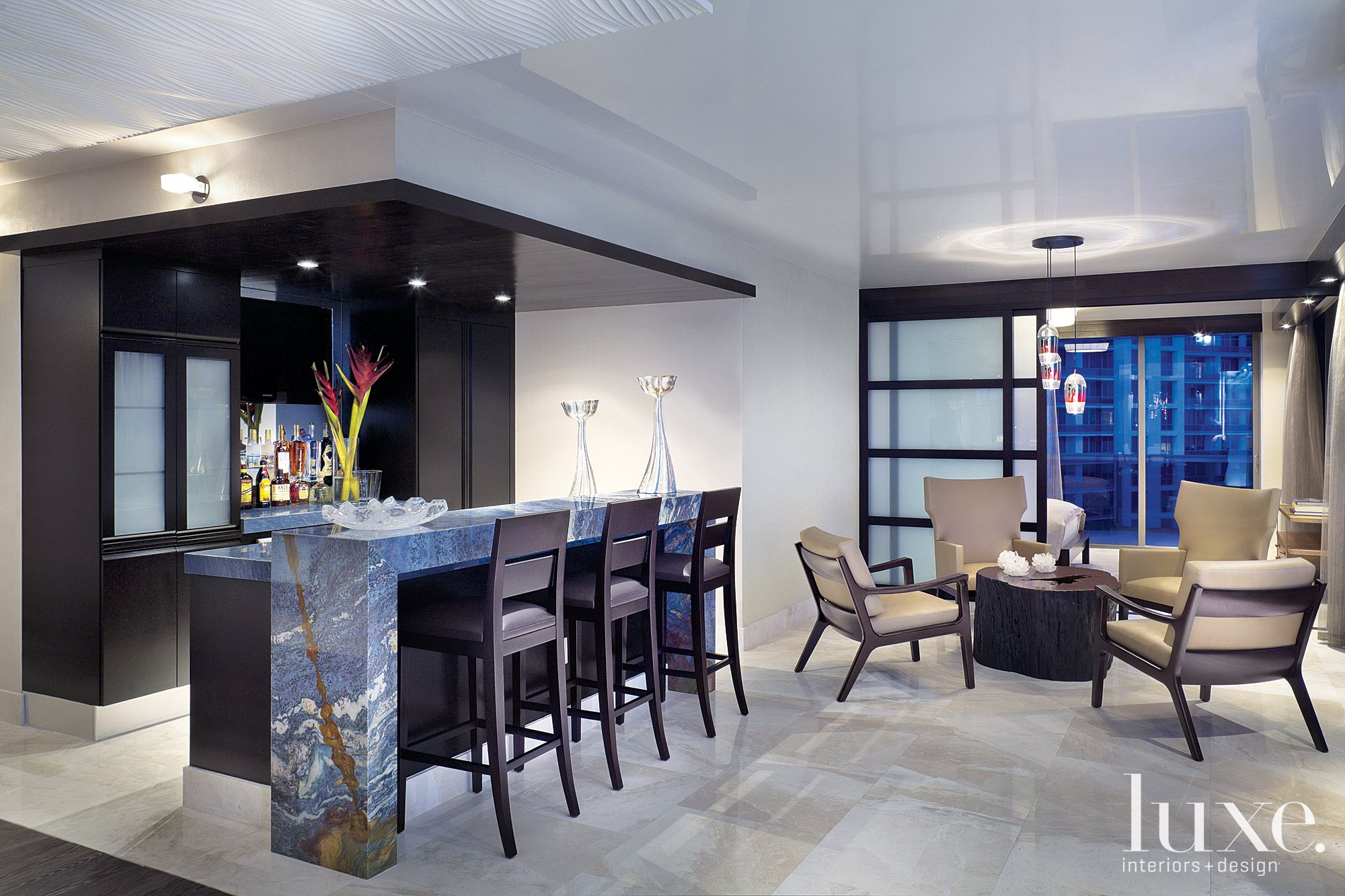 Contemporary Neutral Bar Area with Petrified-Wood Table