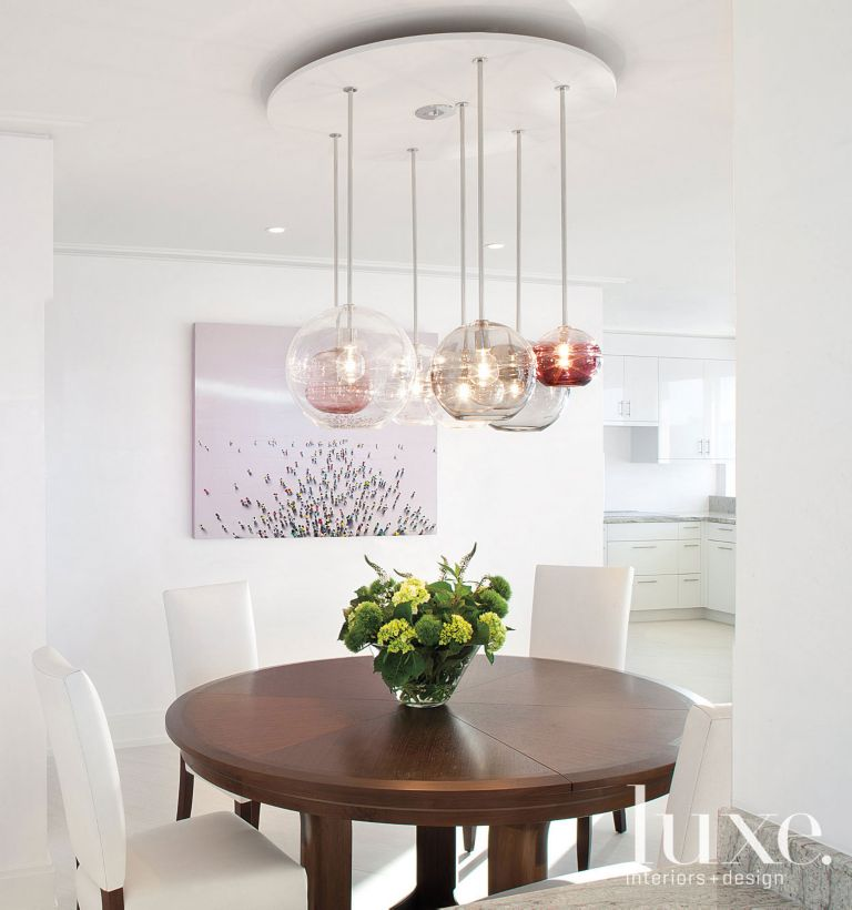Contemporary White Dining Room With Bubble Light Fixture