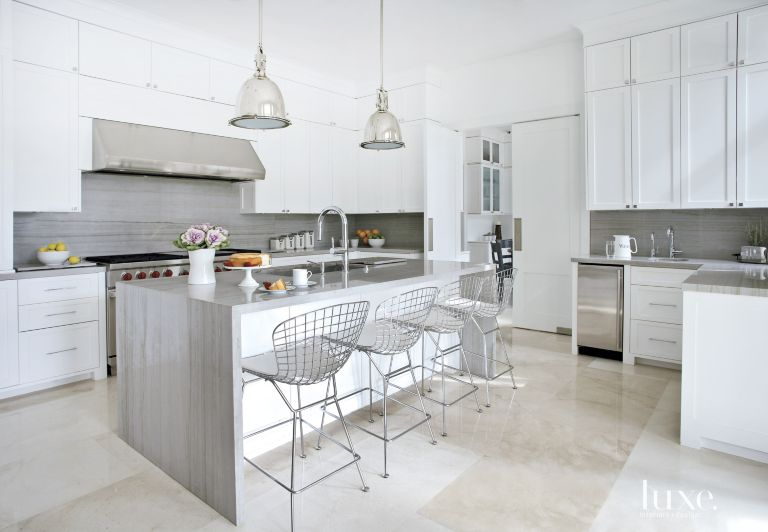 Contemporary White Kitchen With Gray Stone Backsplash And