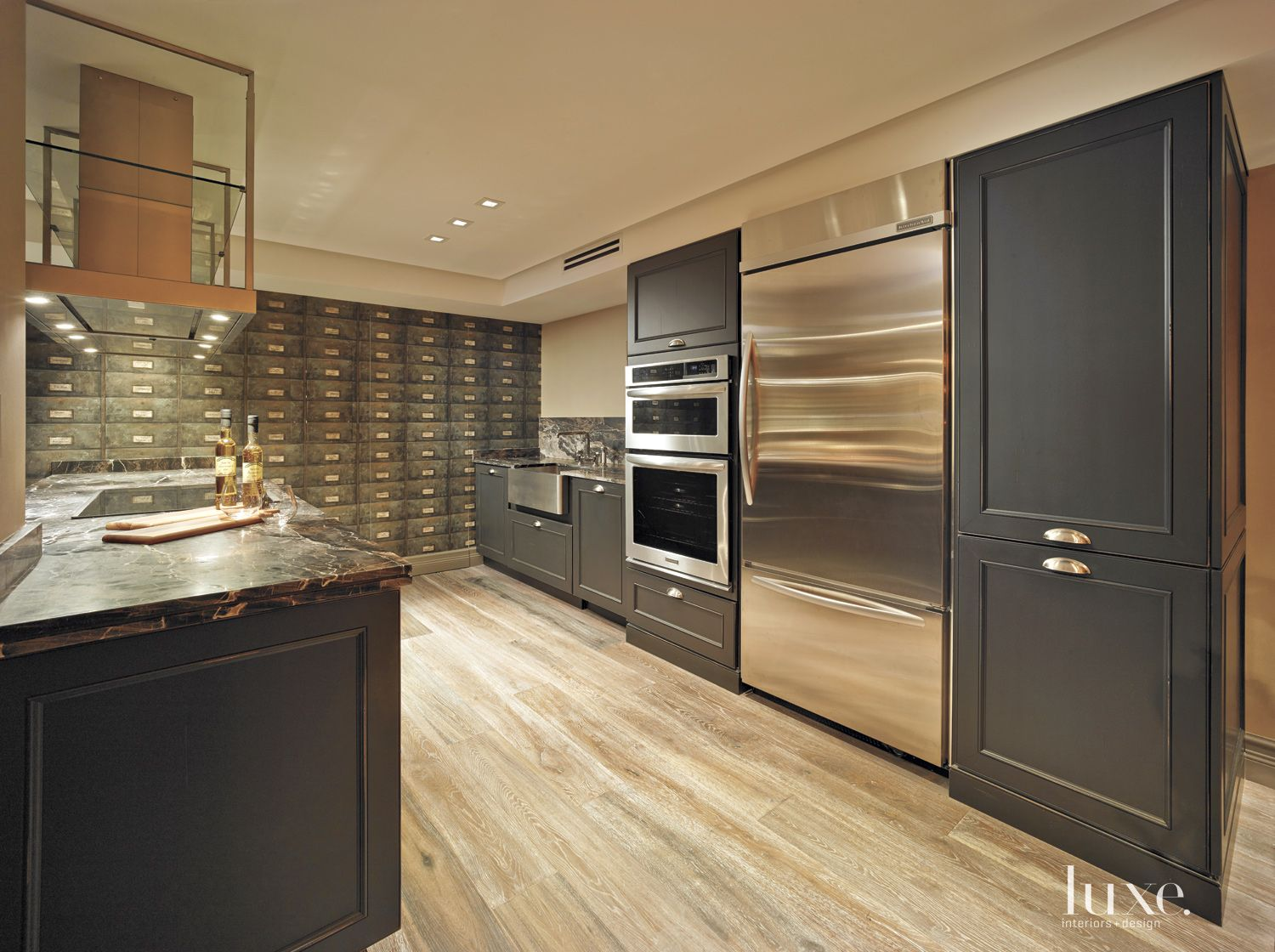 Eclectic Neutral Kitchen with Custom Black Cabinetry