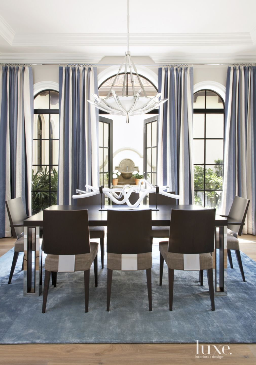 Contemporary White Dining Room with Sculptural Chandelier