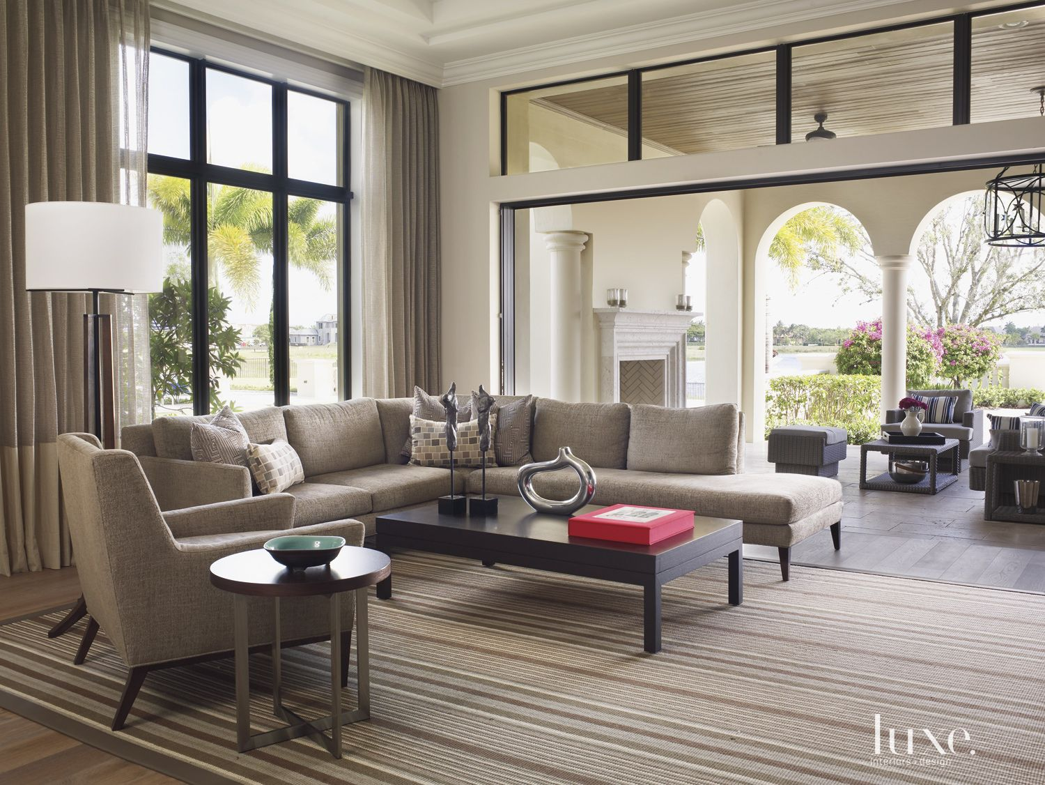 Contemporary Cream Family Room with Indoor-Outdoor Feel