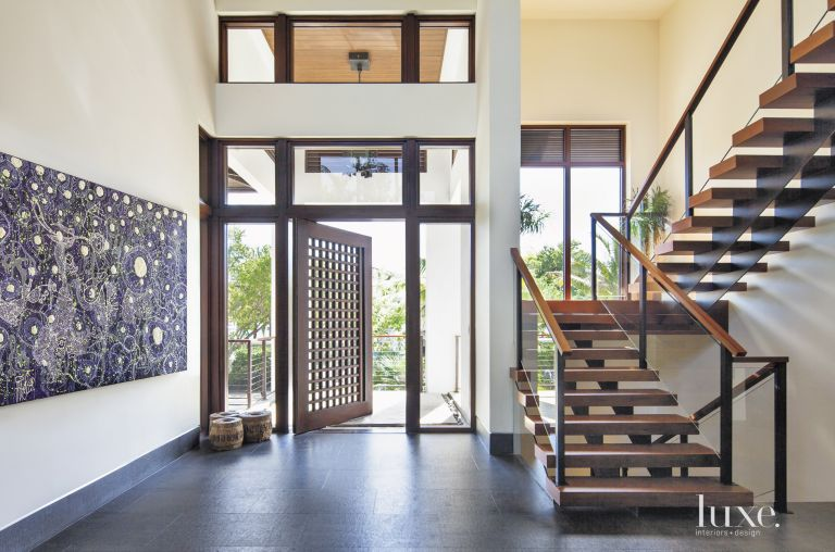 Contemporary White Foyer With Pivot Entry Door Luxe Interiors Design
