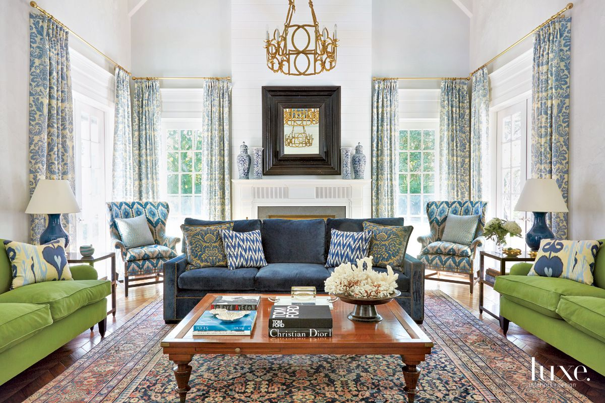 Traditional White Living Room with Blue and Green Sofas ...