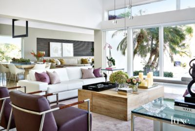 Contemporary White Living Room With Plum Hued Chairs Luxe