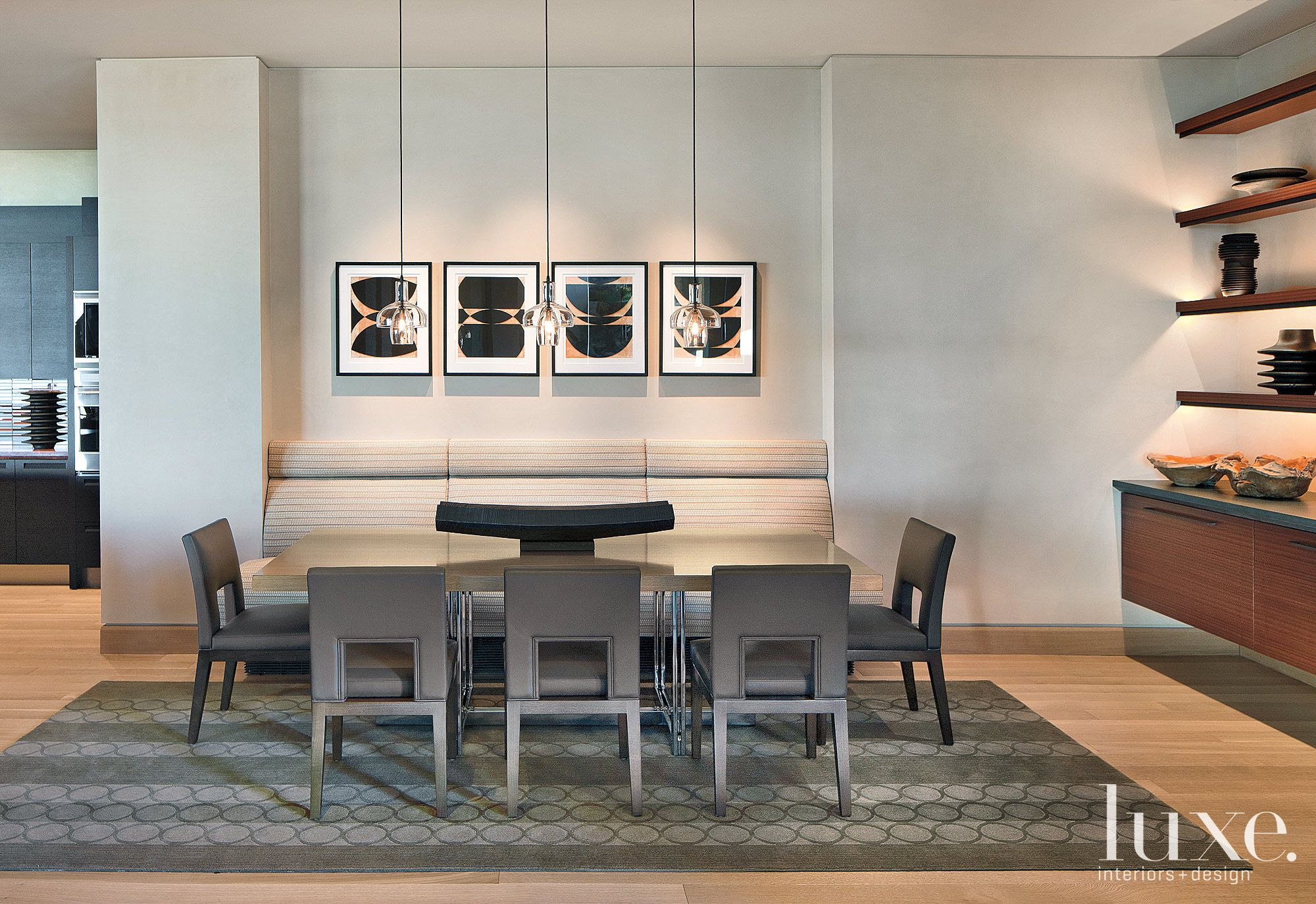 Modern White Breakfast Nook with Artwork over Banquette