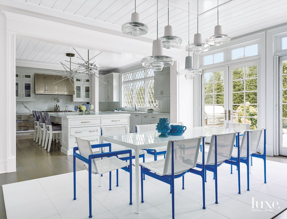 Contemporary White Casual Dining Area with Outdoor Mesh Chairs