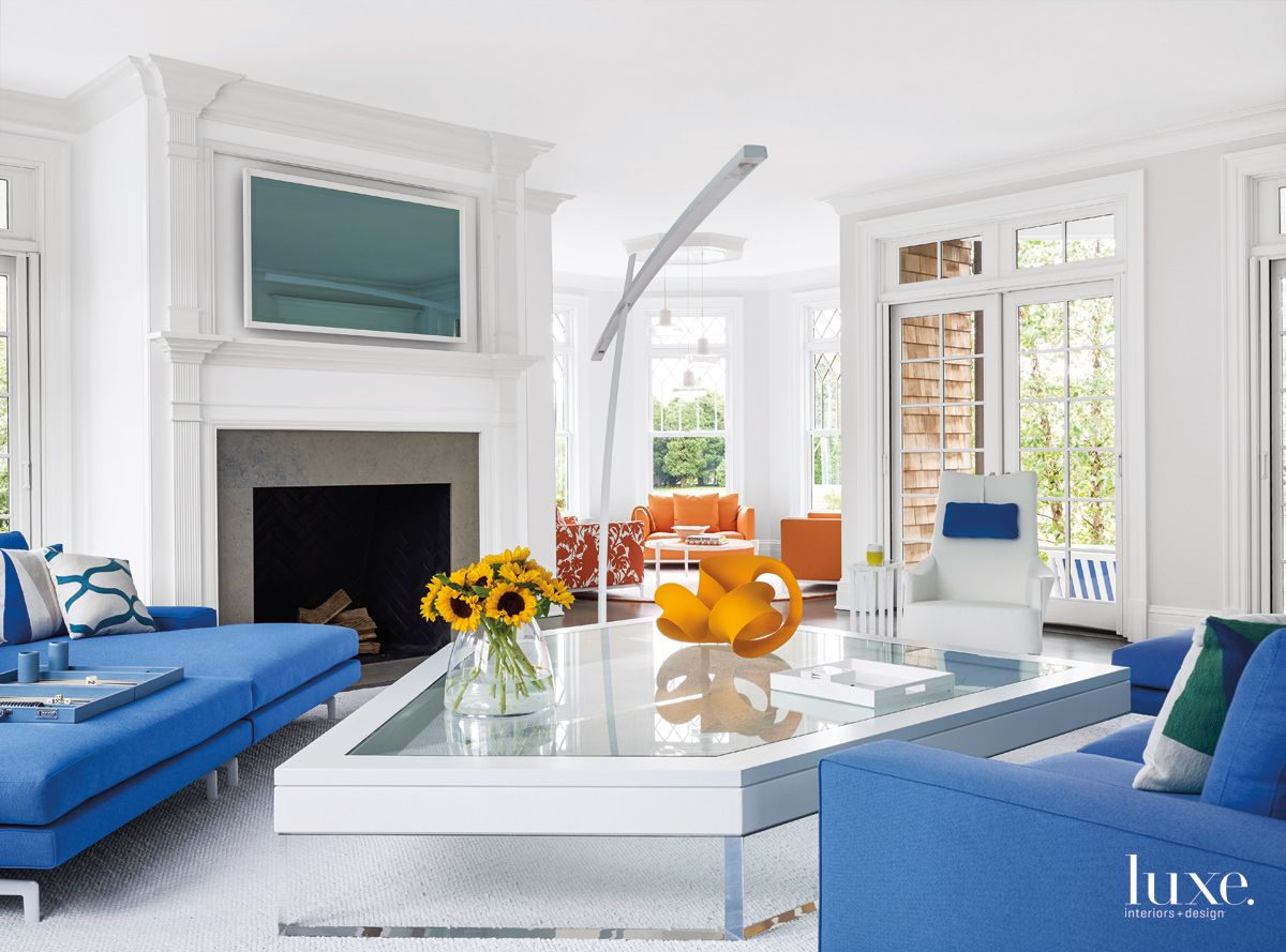 Contemporary White Living Room with Trapezoid Table