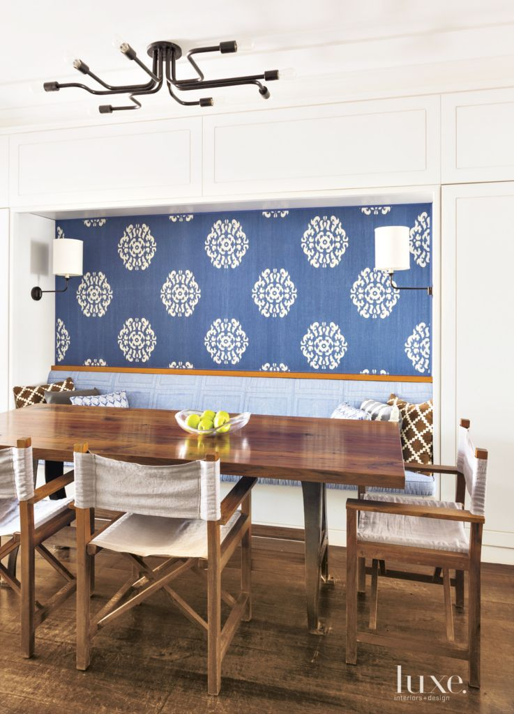 Eclectic White Dining Room With Reclaimed Walnut Table