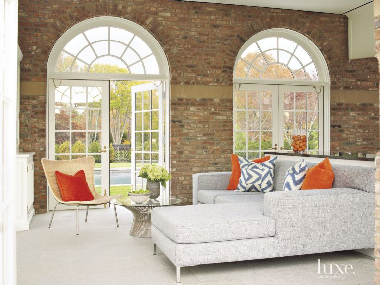 contemporary neutral living room with brick feature wall - luxe
