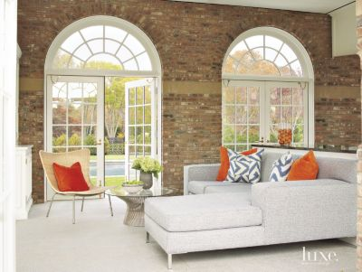 neutral living room with brick feature wall luxe interiors design