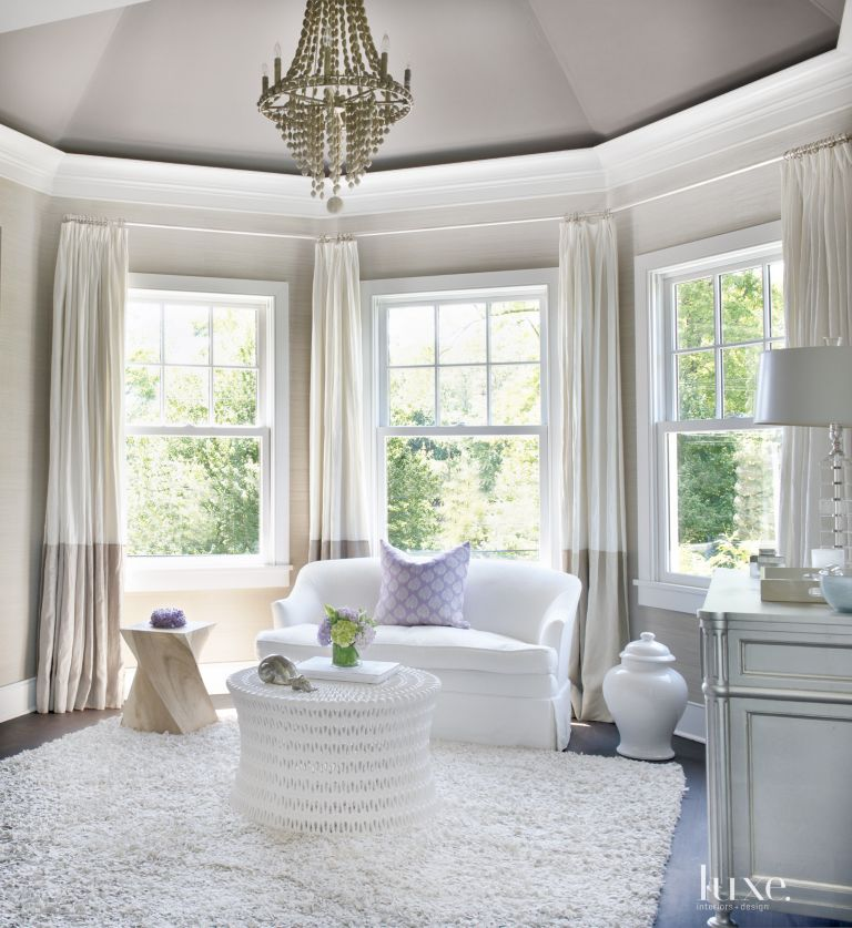 Contemporary Neutral Bedroom Seating Area With Chandelier