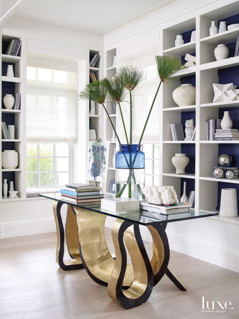 Modern White Library with Artistic Brass Table - Luxe Interiors + Design