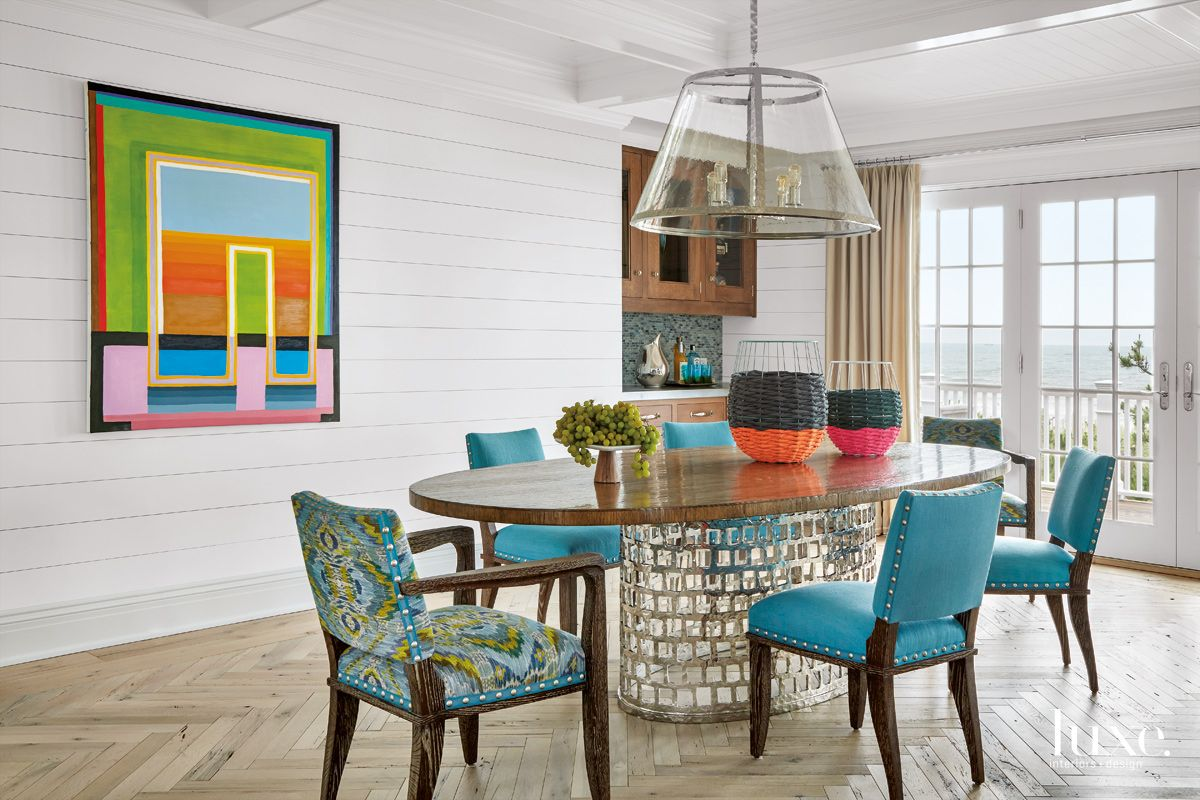 Contemporary White Dining Room with Hammered-Iron Table