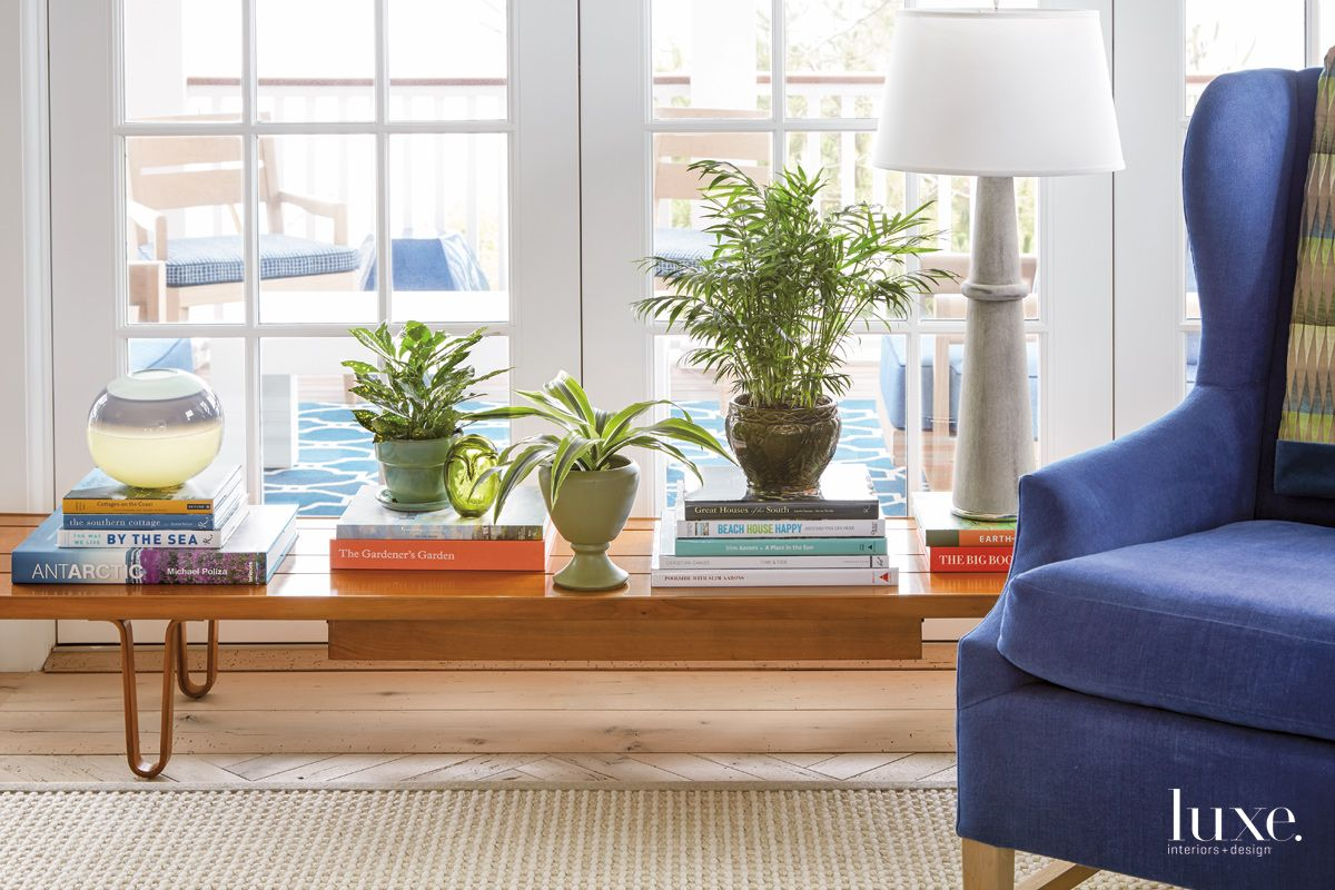 Contemporary Blue Living Room Vignette with Wooden Bench