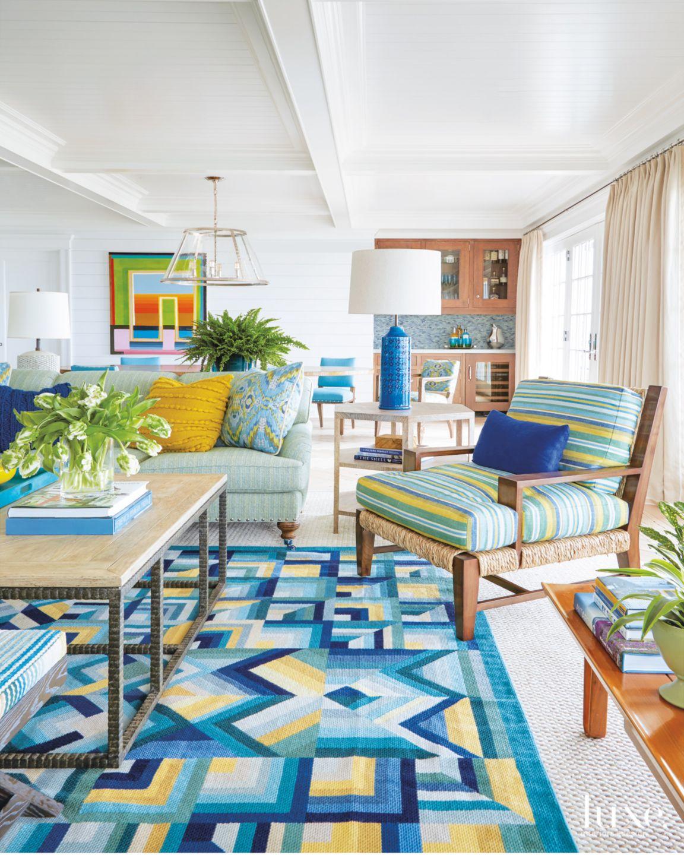 Contemporary Blue Living Room with Kaleidoscopic Rug