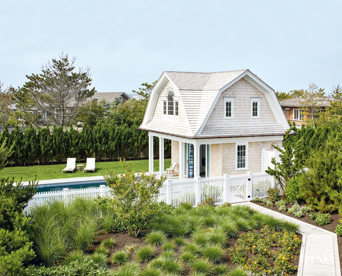 Traditional Neutral Pool House with Wooden Boardwalk