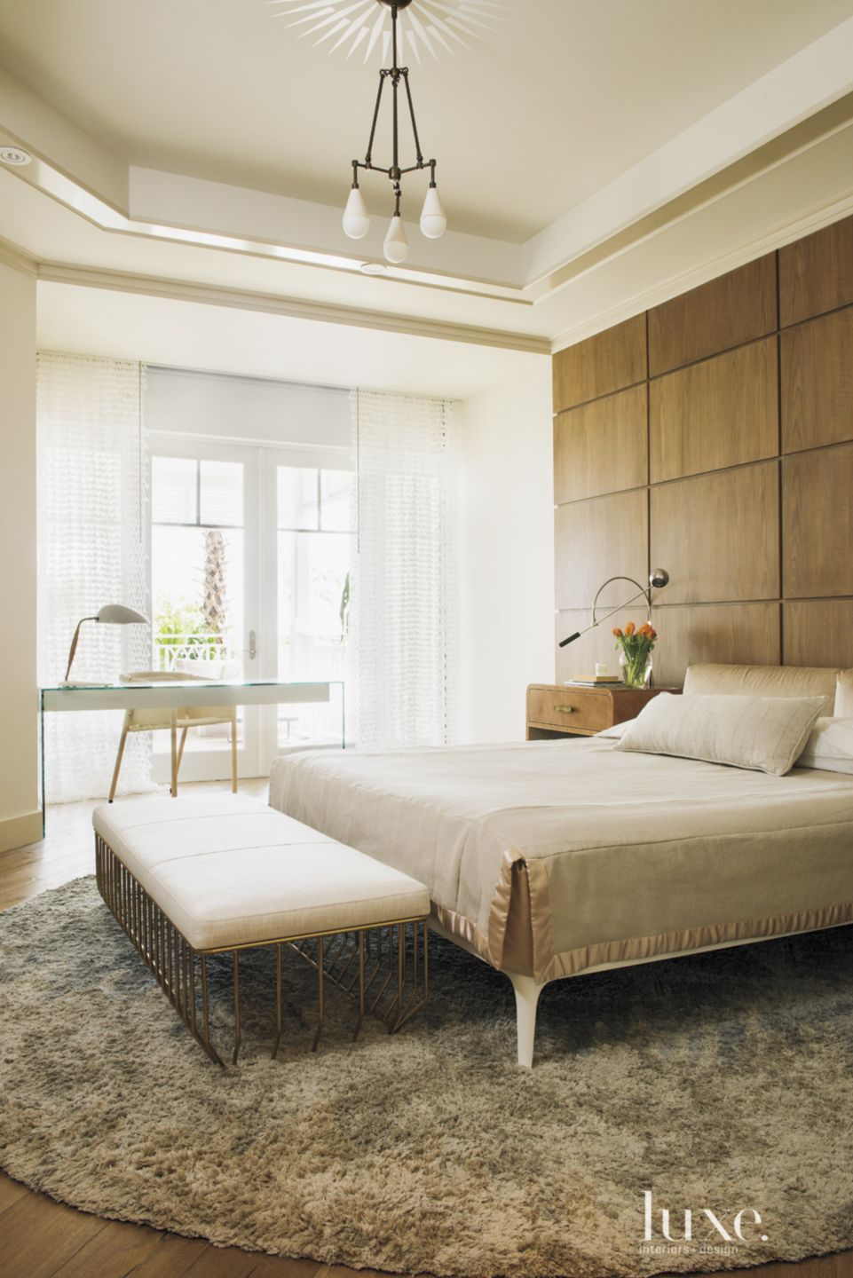 Eclectic White Bedroom with Wood Paneled Wall