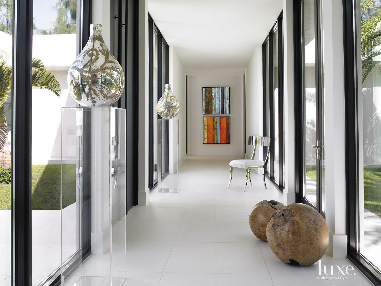 Modern White Hall with Lucite Pedestals