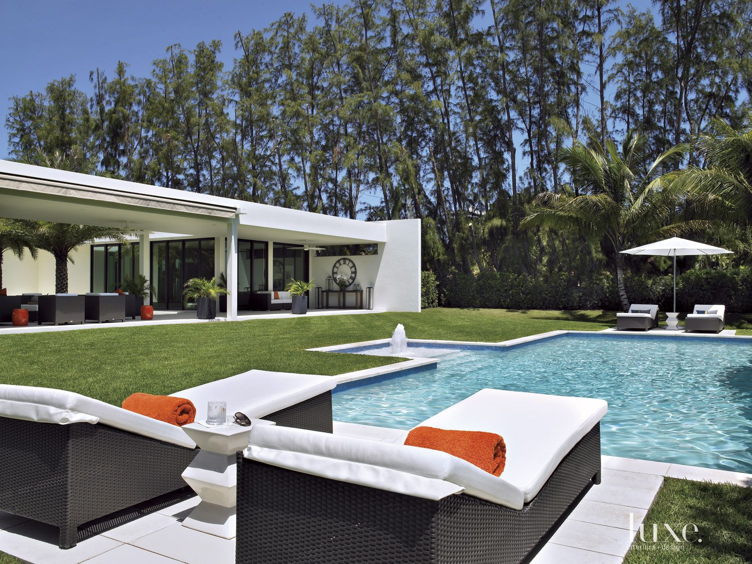 Contemporary Neutral Poolside with Wicker Furniture