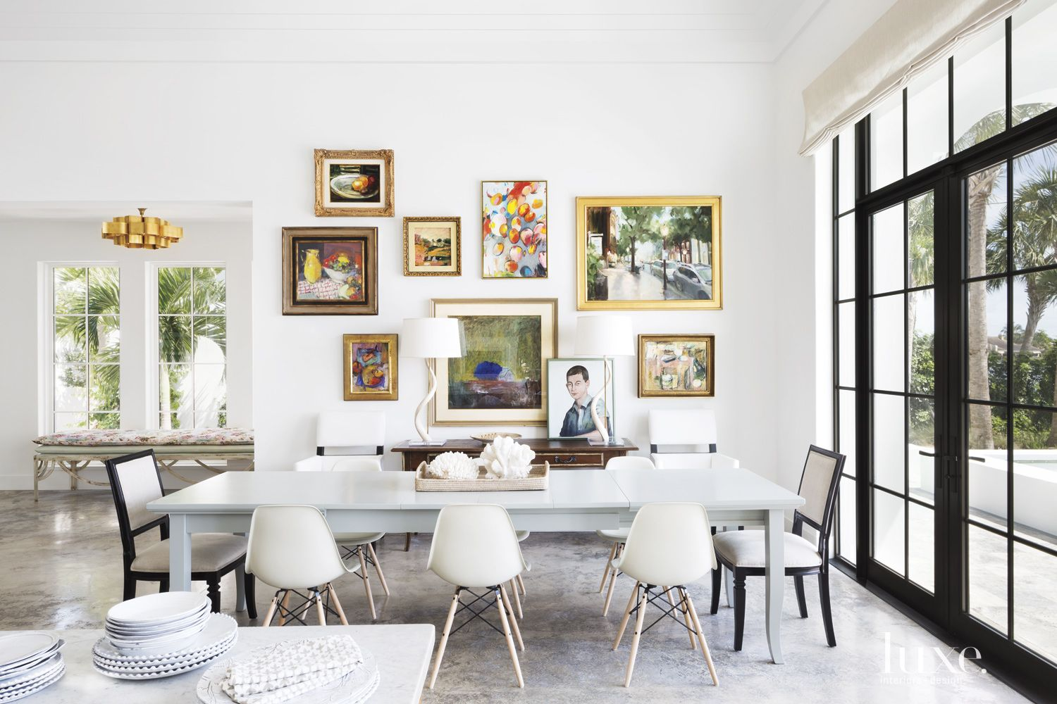 Modern White Dining Room with Gallery Wall