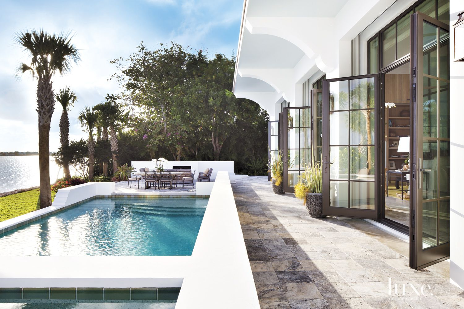 Modern White Poolside Terrace with French Doors