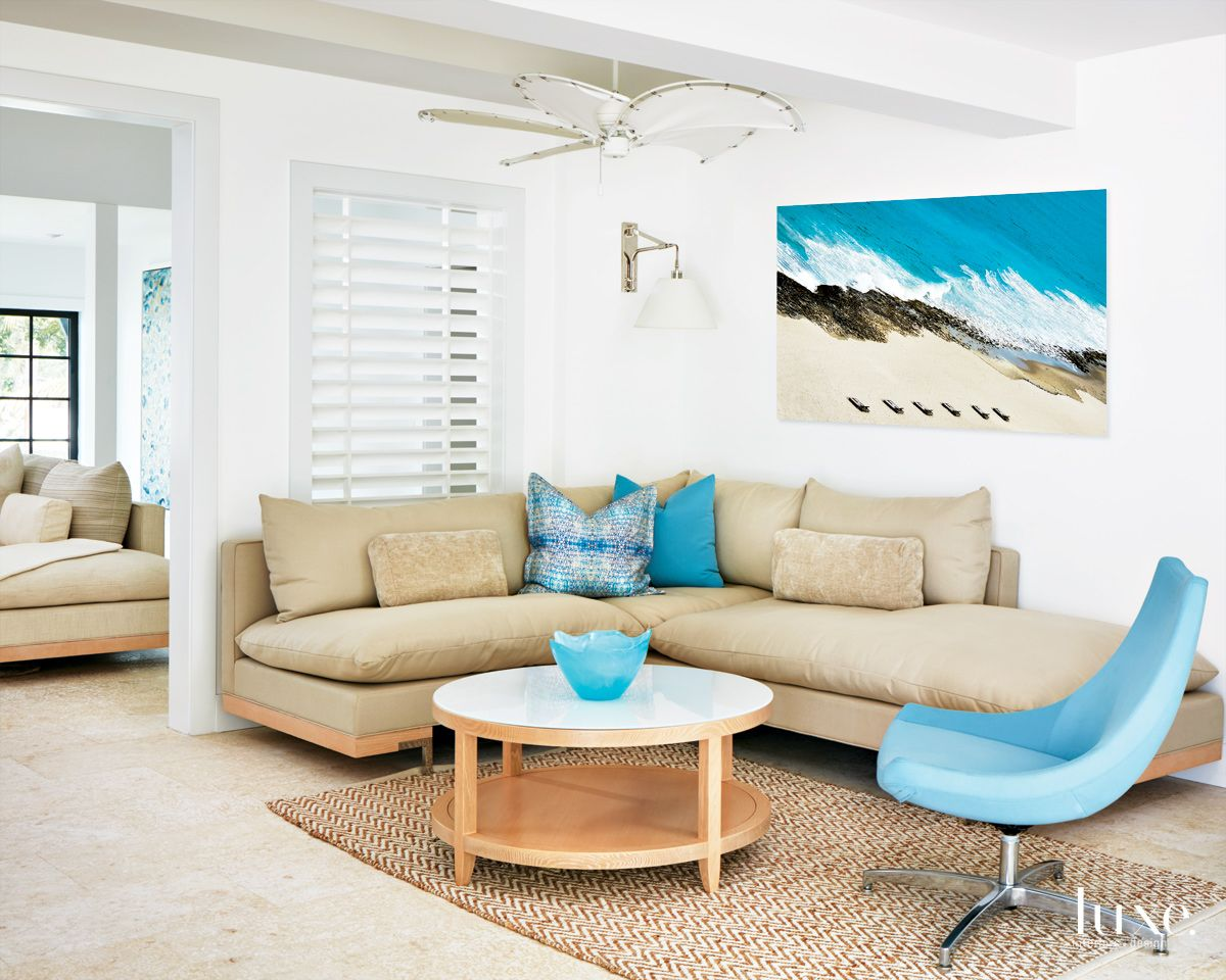 Modern White Family Room with Blue Accents