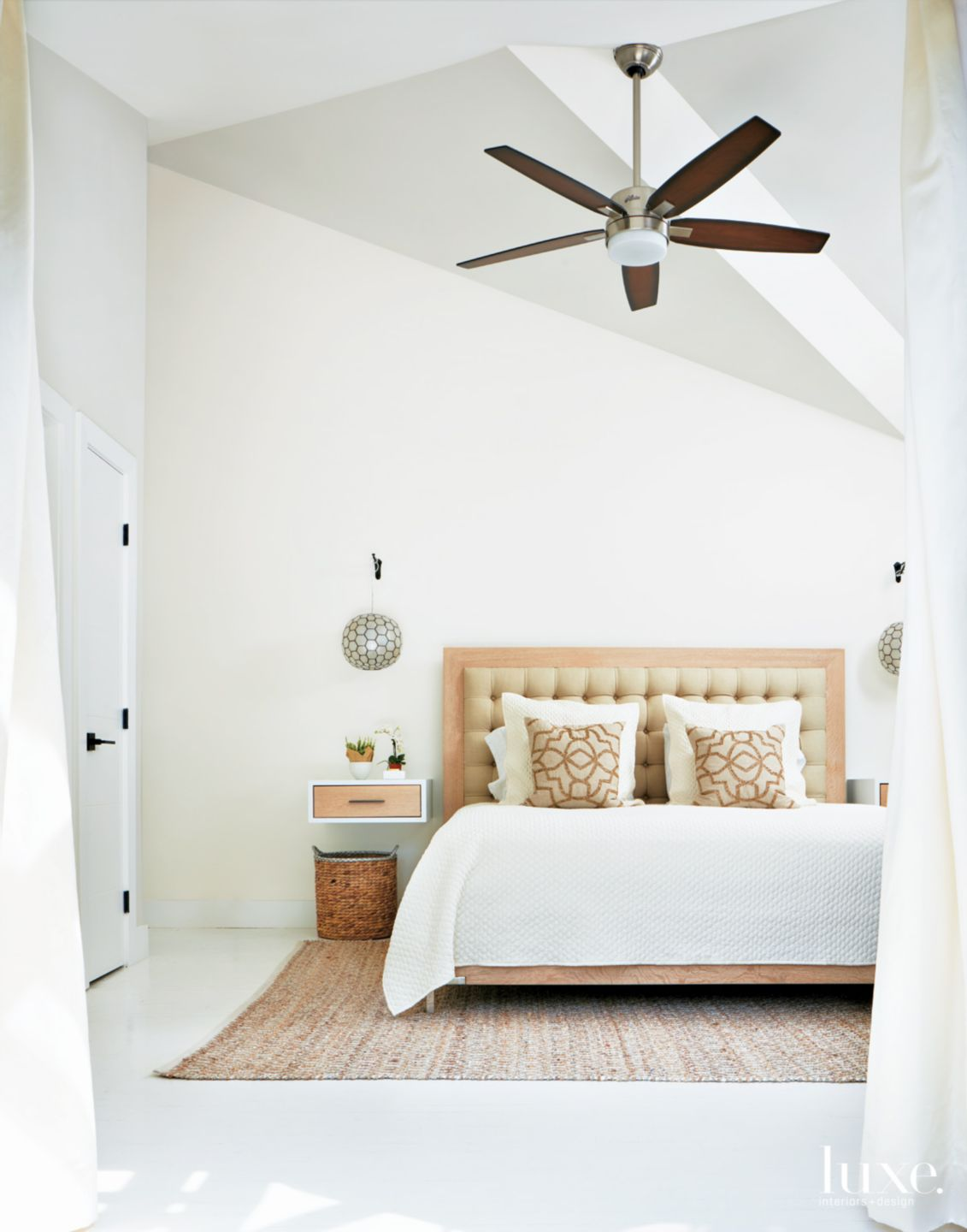 Modern White Bedroom with Tufted Headboard