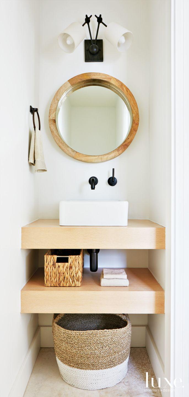 Modern White Powder Room with Porthole-like Mirror