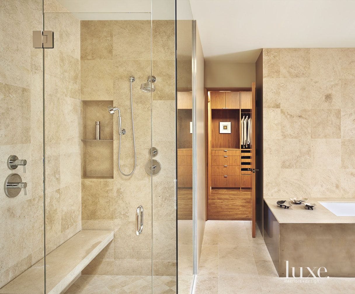 Contemporary Neutral Bathroom with French Limestone Walls