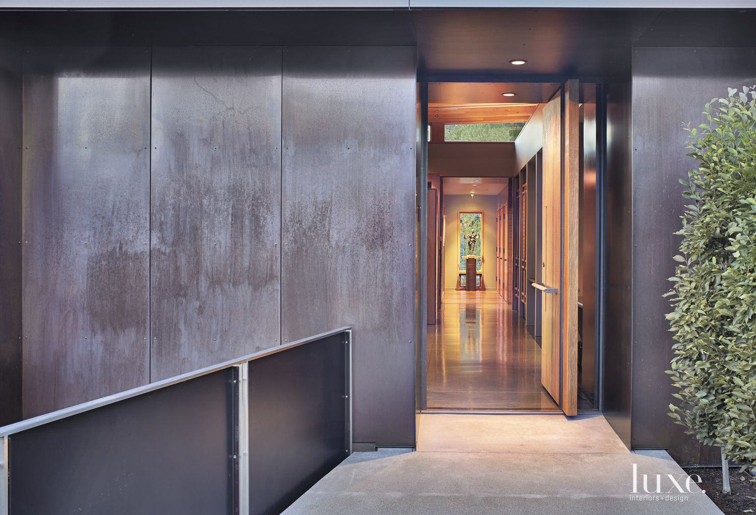 Contemporary Front Entrance with Blackened Steel Facade