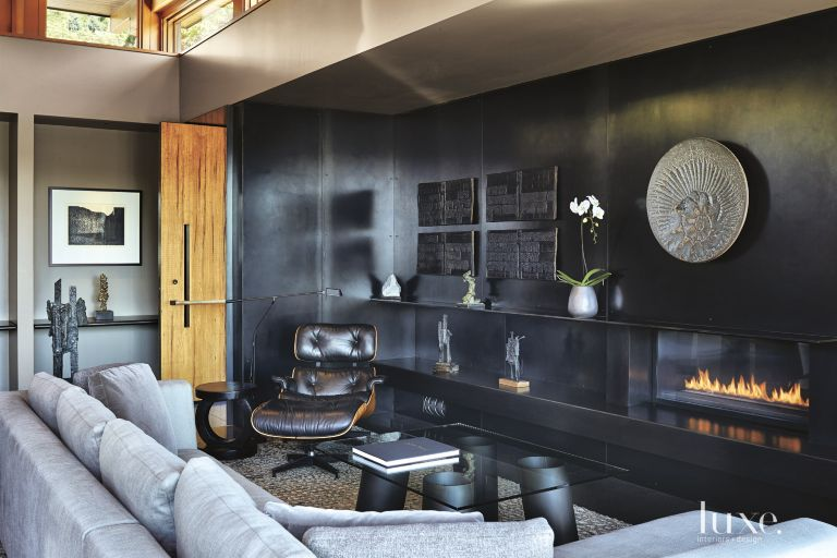contemporary living room with blackened steel accent wall - luxe