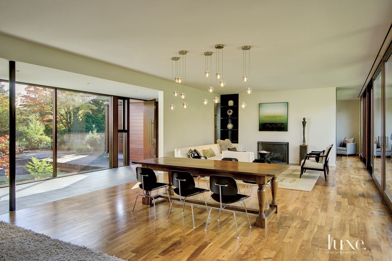 Modern White Living Room with Globe Pendants