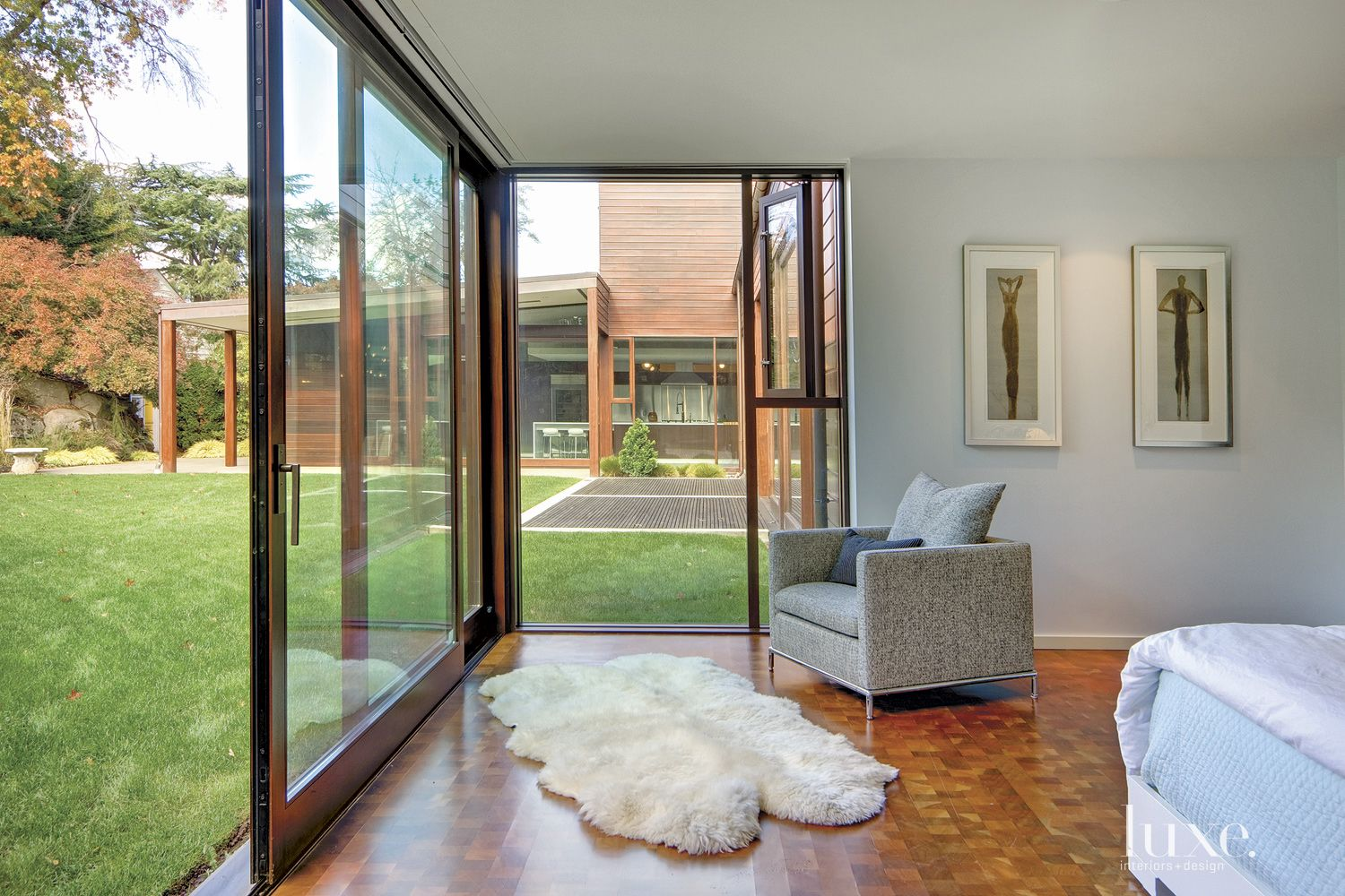 Modern White Bedroom with Lift and Slide Doors