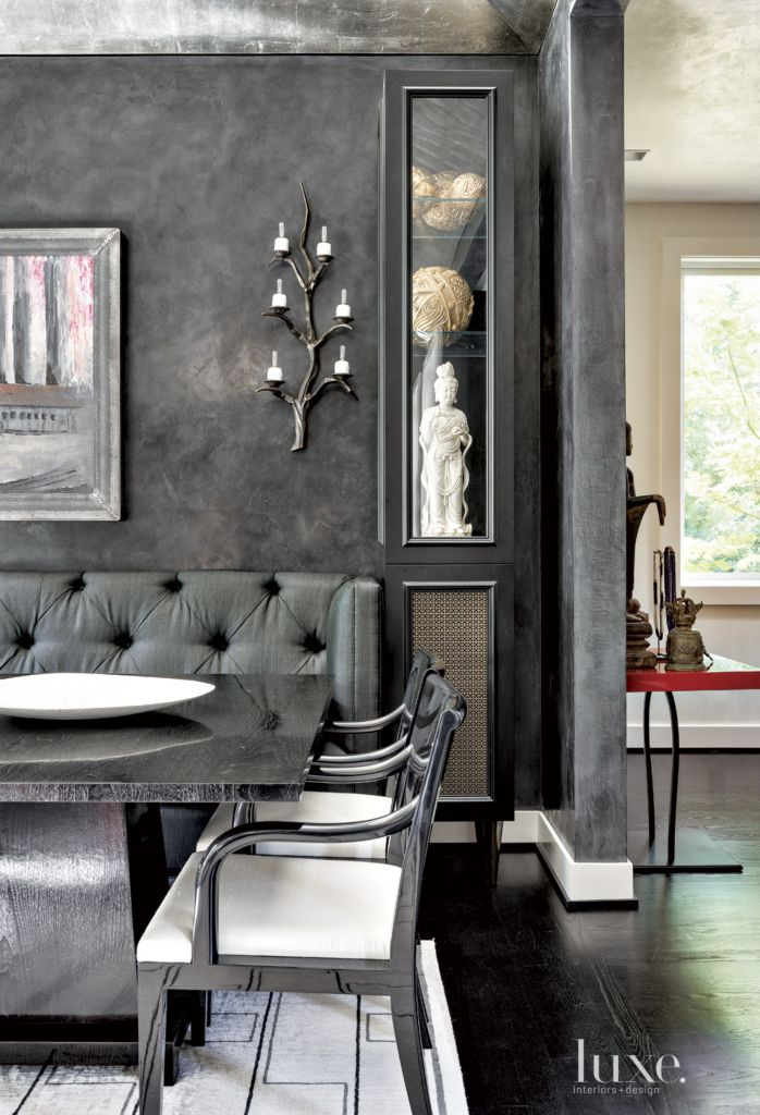 Contemporary Black Dining Room Vignette With Sconces
