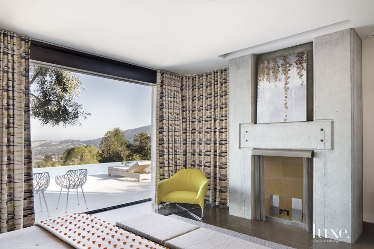 Contemporary Guest Bedroom with Concrete Fireplace. Contemporary Guest Bedroom with Concrete Fireplace   Luxe Interiors