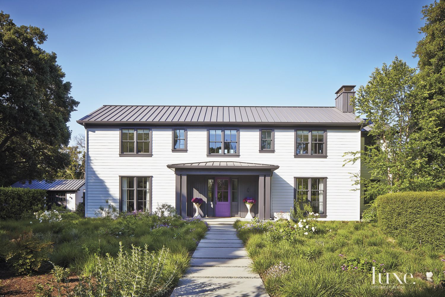 Contemporary White Front Elevation with Purple Door