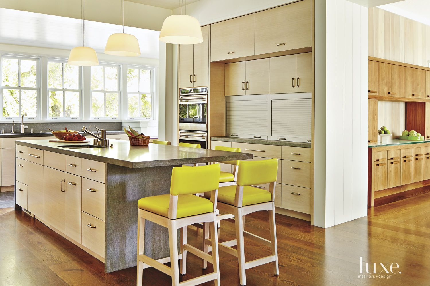 Contemporary White Kitchen with Yellow Barstools