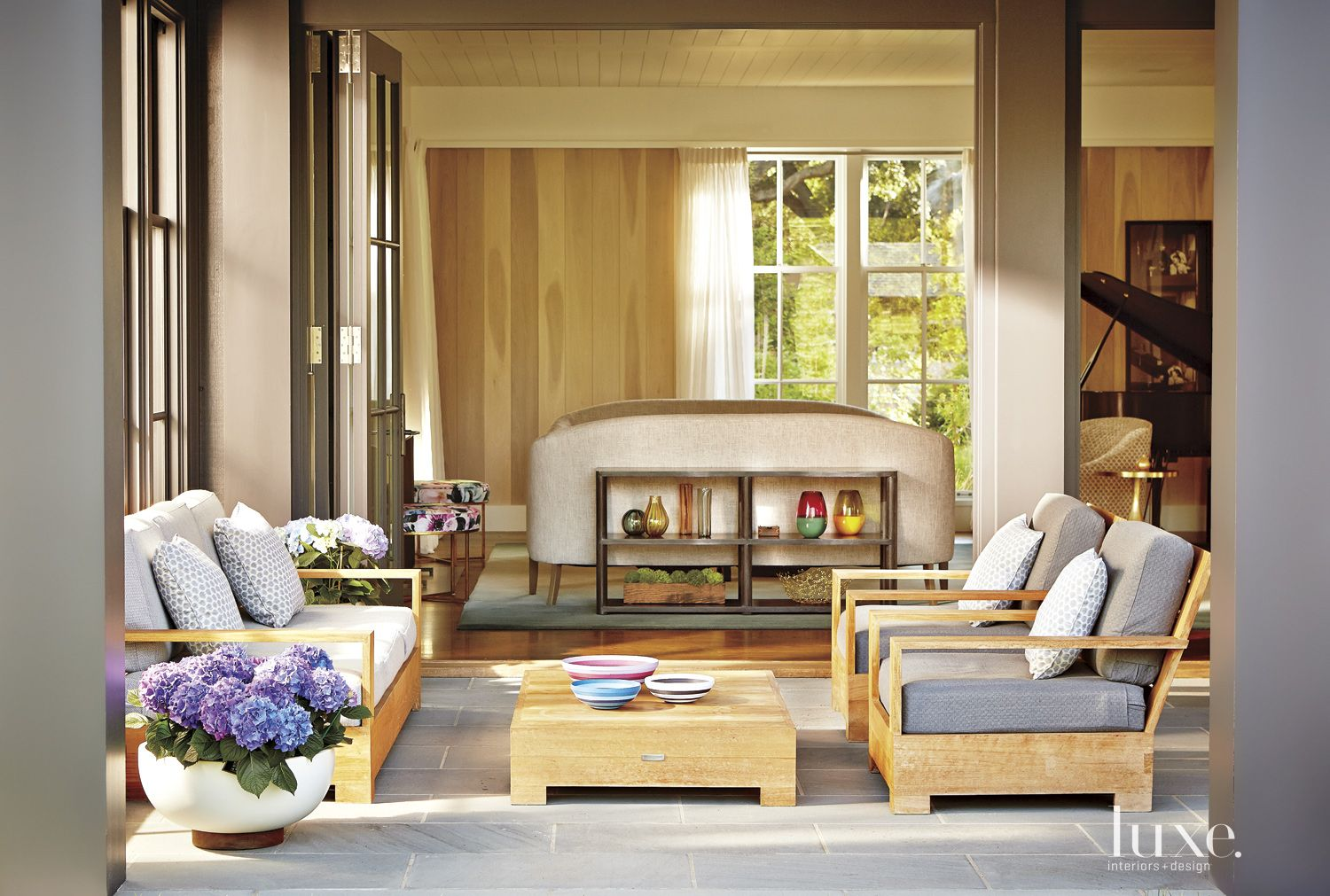 Contemporary Neutral Porch with Folding Doors