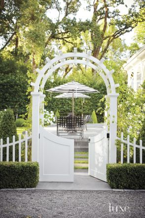 Backyard White Picket Fence and Stone Terrace