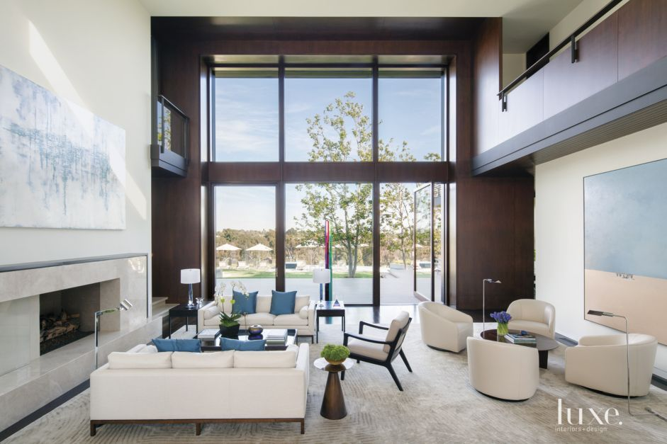 Contemporary white great room with double height ceiling for Double height living room designs