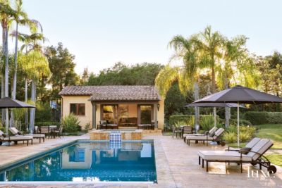 Transitional Neutral Pool Area With Black Umbrellas