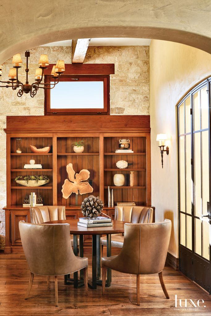 Transitional Neutral Dining Room With Built In Bookshelves