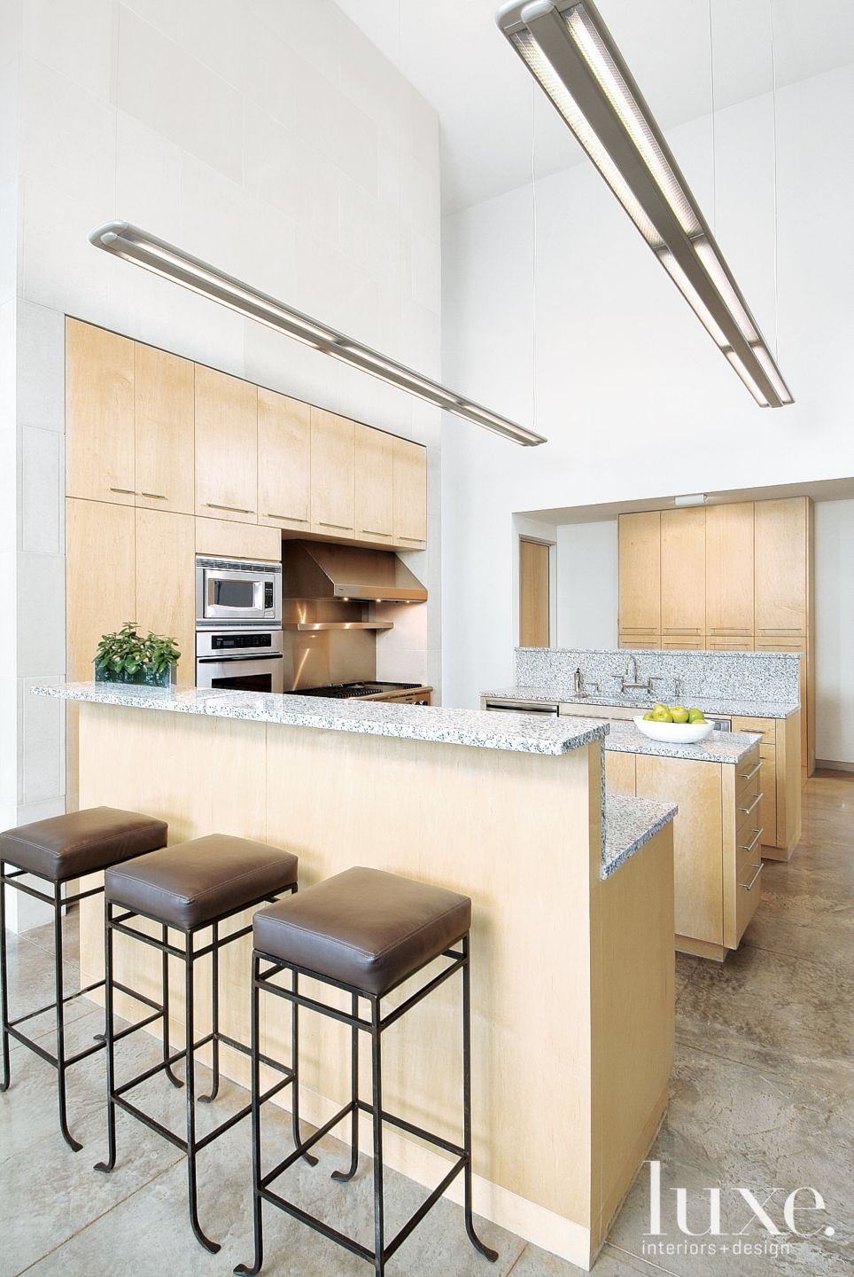 Modern White Kitchen with Maple Cabinetry