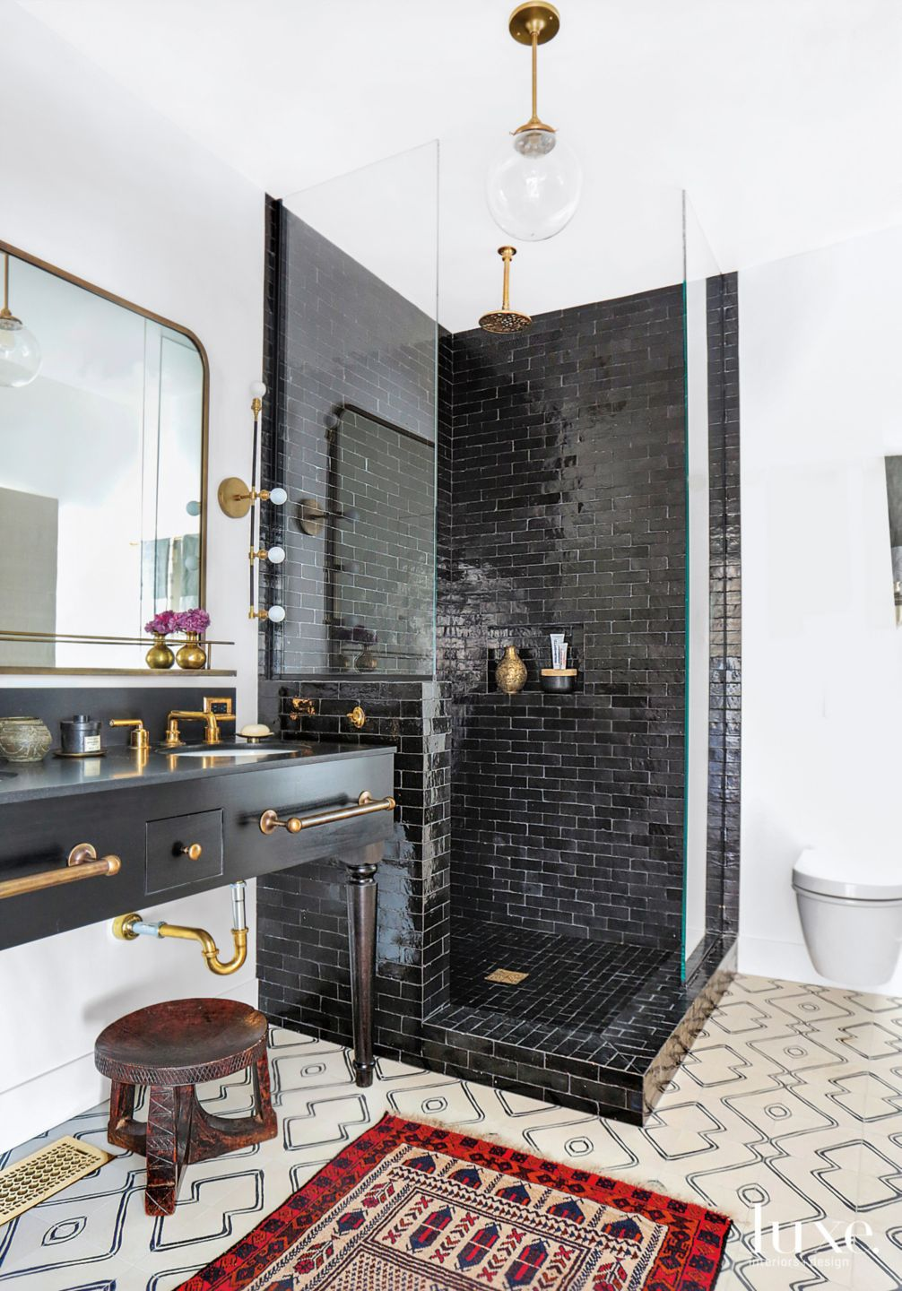 Eclectic White Bathroom with Black-Tiled Shower