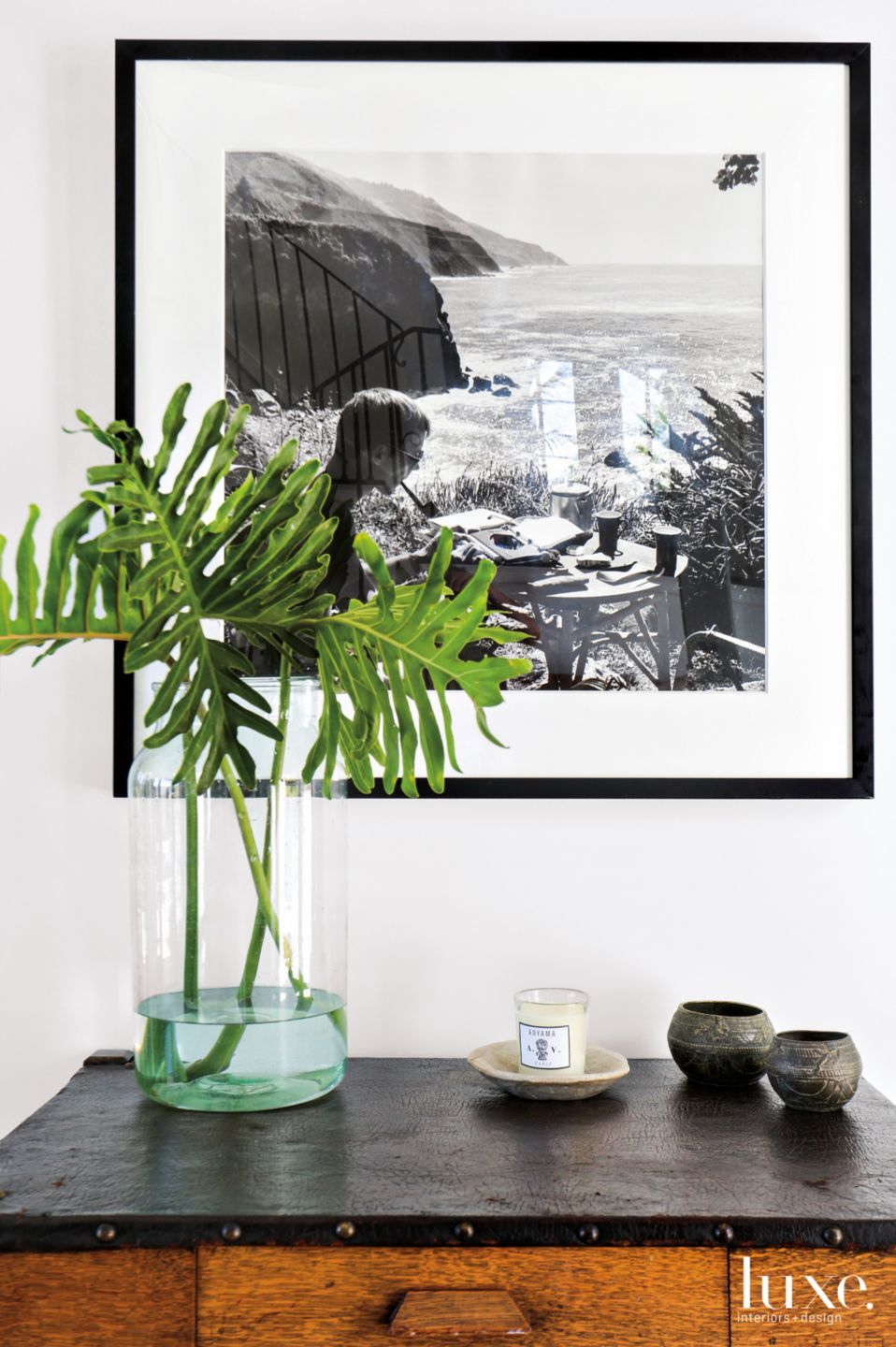 Eclectic White Entry Vignette with Black-and-White Photo