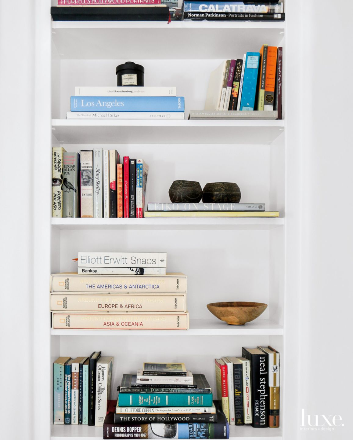 Eclectic White Living Room Vignette with Built-In Shelving