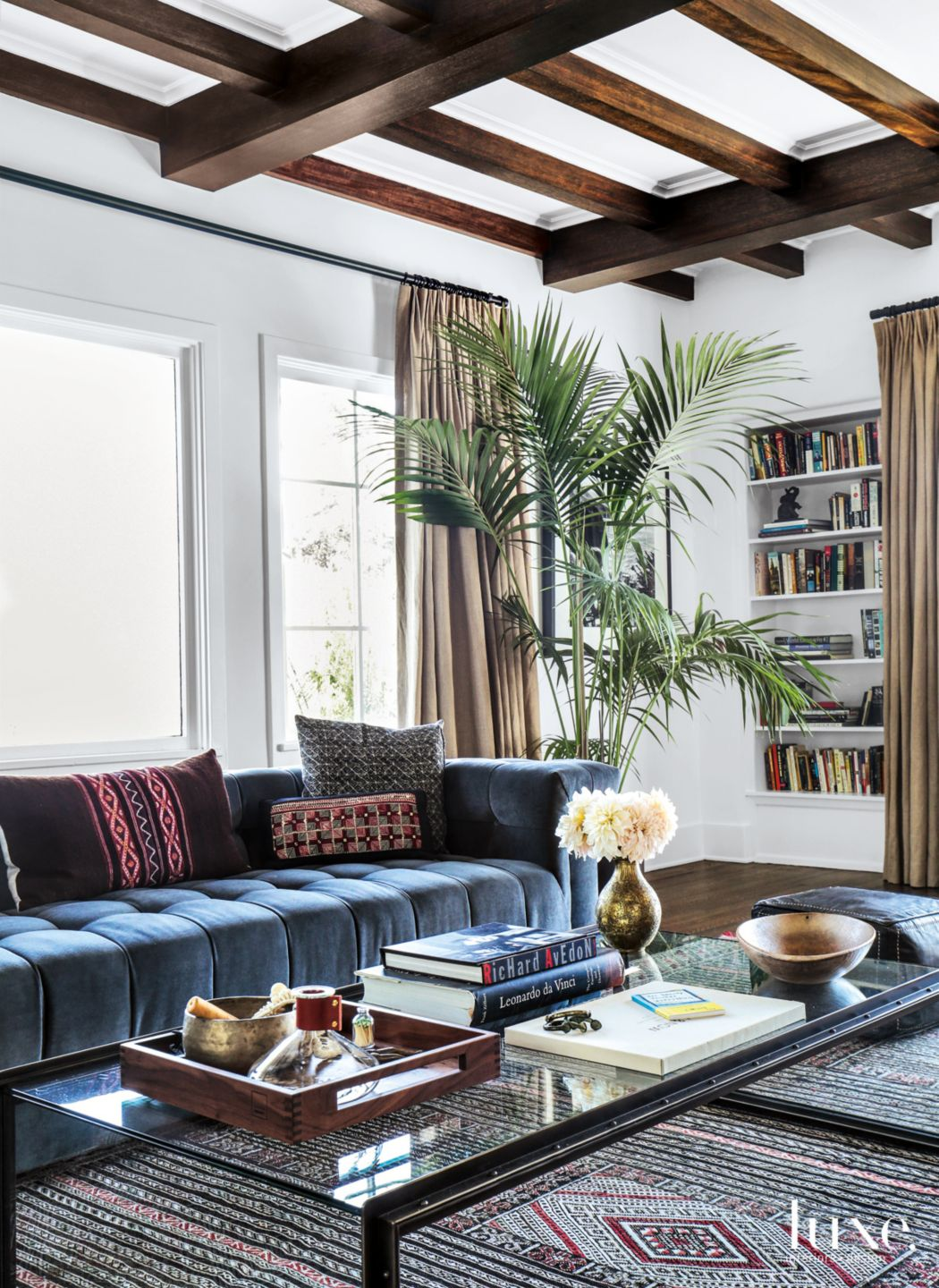 Eclectic White Living Room with Post-and-Beam Ceiling